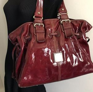 Dooney and Bourke Burgundy patent leather purse!